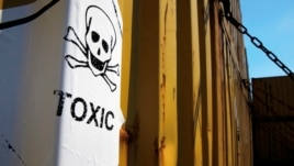 FILE - A sticker on containers carrying Syria's dangerous chemical weapons, on the Danish cargo ship Ark Futura, in Cyprus coastal waters.