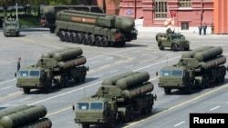 FILE - Russian S-400 surface-to-air missile defense systems are on display during a parade at Red Square in Moscow, Russia, May 9, 2015.