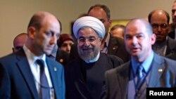 伊朗總統魯哈尼9月23日在紐約聯大開會間隙正前往與秘書長潘基文會晤。