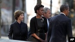 President Barack Obama, first lady Michelle Obama, former President George W. Bush and former first lady Laura Bush visit North Memorial Pond at the National 9/11 Memorial in New York City, Sunday, September, 11, 2011.