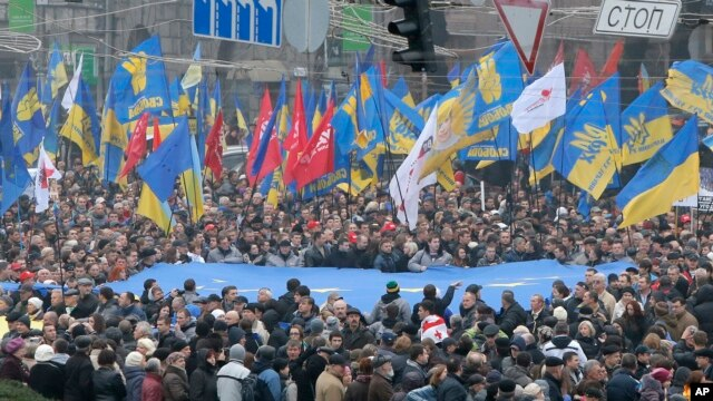 Demonstrators march and carry an EU flag during a protest in Kyiv, Ukraine, Nov. 24, 2013.
