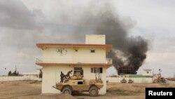 moshi ukitoka kwenye jengobaada ya shambulizi la Taliban katika jimbo la Helmand .