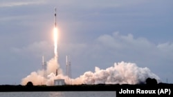 A Falcon 9 SpaceX rocket with the Israeli-owned Amos 17 commercial communications satellite lifts off from space launch complex 40 at the Cape Canaveral Air Force Station in Cape Canaveral, Fla., Tuesday, Aug. 6, 2019. (AP Photo/John Raoux)