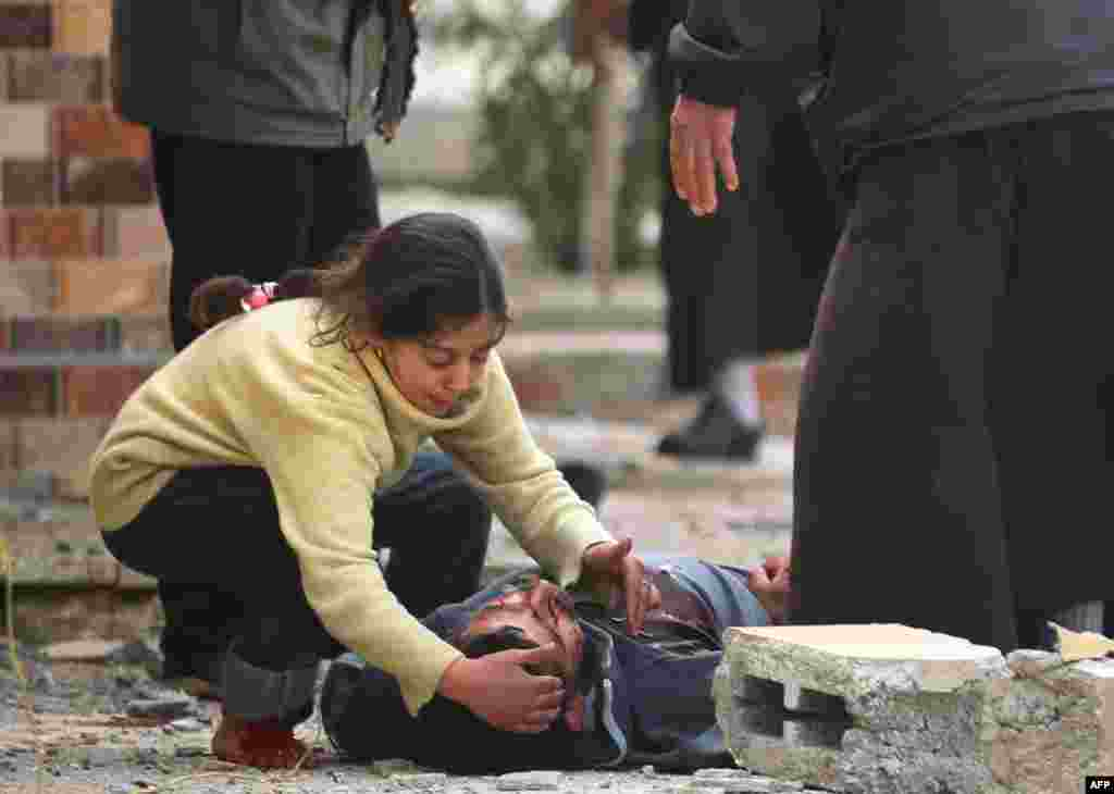 An Iraqi girl cries over her father's body, who was killed by a mortar shell fired by Islamic State (IS) group jihadists on civilians who were gathered to receive aid, in Al-Risala neighborhood in west Mosul, Iraq.