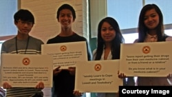 Young people from Lowell Community Health Center's Teen BLOCK held banners raising awareness of prescription drugs, during Opiate Awareness Week, at Lowell Community Health Center, on October 21, 2013.