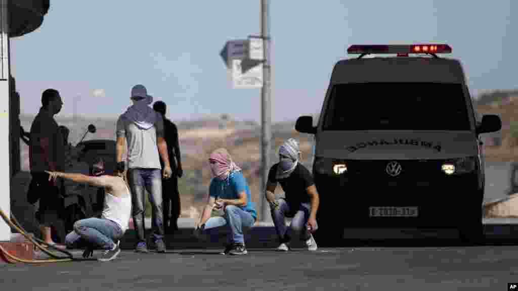 Zanga-zanga da Falasdinawa da Ramallah, West Bank, 25 Yuli 2014.