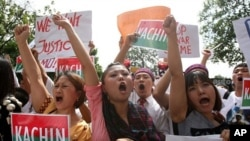 Burmese people living in Malaysia chant slogans during a protest to condemn the persecutions committed by the Burmese army towards ethnic minorities, near the Burmese Embassy in Kuala Lumpur, Malaysia, October 11, 2011.