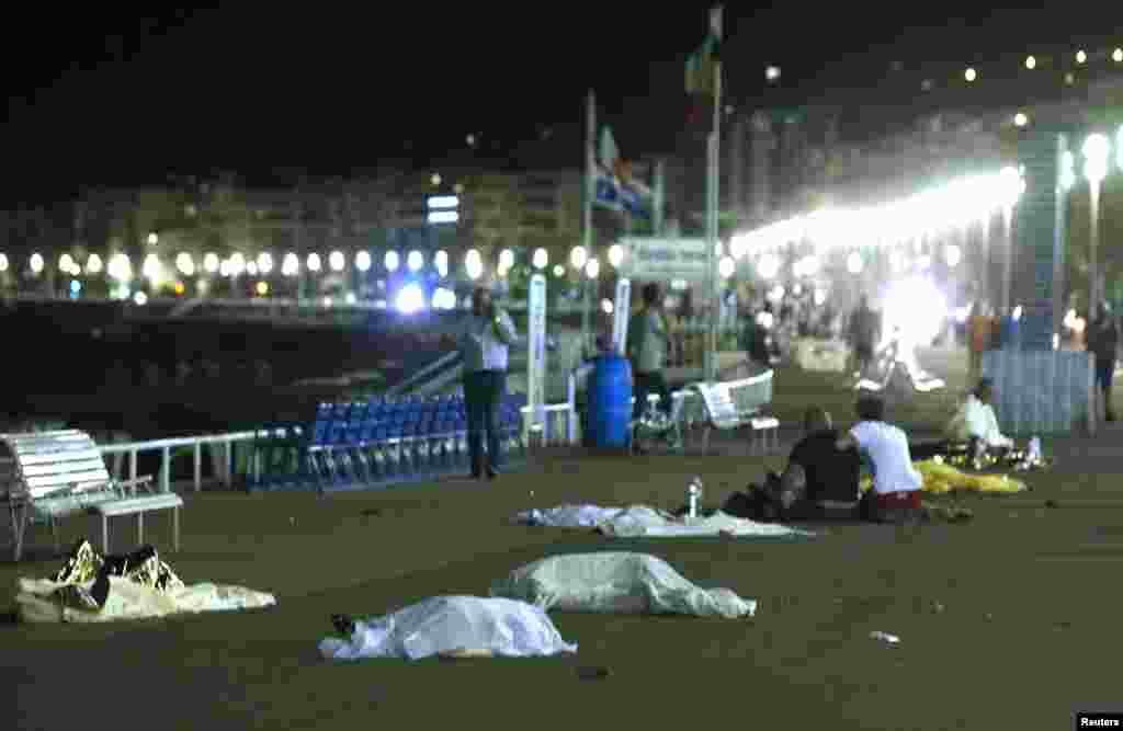 Bodies are seen on the ground after a truck ran into a crowd in Nice, France during a celebration for the Bastille Day national holiday, July 14, 2016.