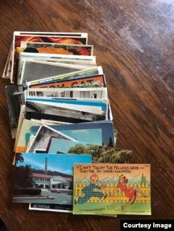 "This stack of postcards Greg has sent to Eve. She calls it another ""workaround"" for not being able to see each other as often during the COVID pandemic. (Image courtesy of Eve)"