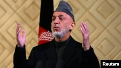 Afghan President Hamid Karzai speaks during a ceremony to mark the 80th anniversary of Kabul University in Kabul, May 9, 201