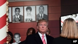 President Donald Trump gets a tour of the new Mississippi Civil Rights Museum in Jackson, Miss., Dec. 9, 2017.