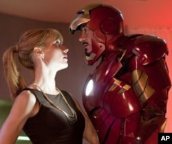"Pepper Potts (Gwyneth Paltrow), and Tony Stark (Robert Downey Jr.) in ""Iron Man 2."" © 2010 MVLFFLLC. TM & © 2010 Marvel. All Rights Reserved."