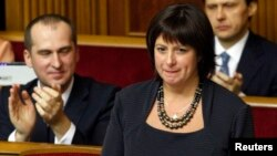 U.S. national Natalie Jaresko, who will serve as finance minister in Ukraine's new government, stands before MPs during a session of parliament in Kyiv Dec. 2, 2014.