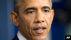 President Barack Obama speaks during a news conference at the White House in Washington, Dec. 19, 2014.