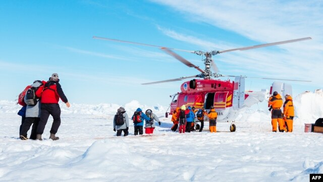 This image taken by expedition doctor Andrew Peacock of www.footloosefotography.com on January 2, 2014 shows a helicopter picking up the first batch of passengers from the stranded Russian ship MV Akademik Shokalskiy.