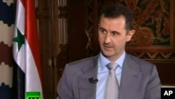 ဆီရီးယားသမၼတ Bashar Al -Assad ရုရွားတူေဒး ရုပ္ျမင္သံၾကားနဲ႔ အင္တာဗ်ဴးမွာ ေျပာၾကားေနစဥ္ ( ႏိုဝင္ဘာ ၈၊ ၂၀၁၂။)