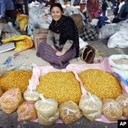 A woman waits for customers at a vegetable market in Bhutan's capital, Thimpu (File)