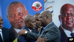 FILE - Felix Tshisekedi (R) of Congo's Union for Democracy and Social Progress opposition party, hugs Vital Kamerhe (L) of Congo's Union for the Congolese Nation opposition party, after being endorsed Kamerhe at a press conference in Nairobi, Kenya, Nov. 23, 2018.
