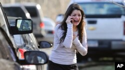 A woman waits to hear about her sister, a teacher, following a shooting at the Sandy Hook Elementary School in Newtown, Connecticut.