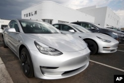 Tesla Model 3 is one of many electric vehicles powered by lithium-ion batteries. (AP Photo/David Zalubowski, File)