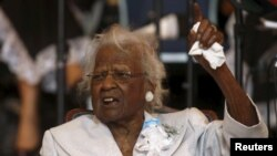 Jeralean Talley, who died Wednesday at age 116 and had been deemed the world's oldest person, addresses the congregation during a church service and her birthday celebration in Inkster, Michigan, May 24, 2015.