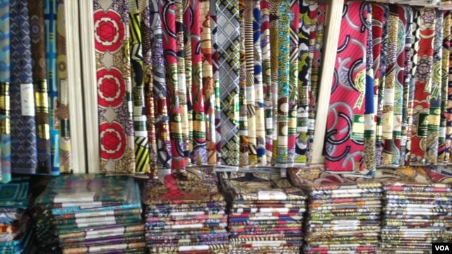 Foreign textile fabrics and materials in a Nigerian shop, December 5, 2012. (I. Kure - for VOA)