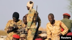 South Sudanese soldiers are seen during a ceremony marking the restarting of crude oil pumping at the Unity oil fields, Jan. 21, 2019. Beginning in March, the government will deduct one day's salary from civil servants' paychecks each month to support the recent peace deal.