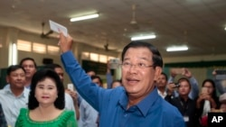 FILE - Prime Minister Hun Sen of the Cambodian People's Party shows off his ballot paper at Takhmau polling station in Kandal province, southeast of Phnom Penh, June 4, 2017.