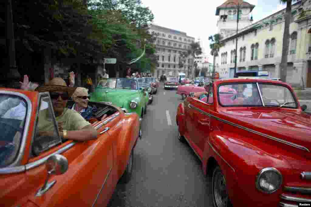 Tourists enjoy a ride in vintage cars in old Havana, Cuba, Jan. 17, 2016.