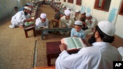 An undated photo of Pakistani children studying the Quran at a religious school in Lahore, Pakistan. Pakistan's religious schools, or madrassas, face renewed scrutiny with many alleging that the schools serve as breeding grounds for violent extremists.