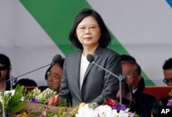 FILE - Taiwan's President Tsai Ing-wen delivers a speech during the National Day celebrations in front of the Presidential Building in Taipei, Taiwan, Tuesday, Oct. 10, 2017.