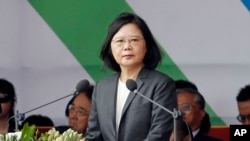 Taiwan's President Tsai Ing-wen delivers a speech during the National Day celebrations in front of the Presidential Building in Taipei, Taiwan, Tuesday, Oct. 10, 2017. (AP Photo/Chiang Ying-ying)
