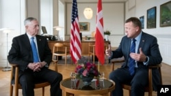Danish Prime Minister Lars Loekke Rasmussen (R) gestures during a meeting with United States Defense Minister, former General James Mattis (L) in the prime minister's office at Christiansborg Castle in Copenhagen, Denmark, May 9, 2017.