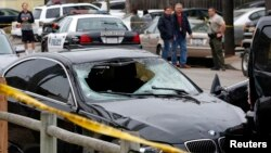 The vehicle of the alleged shooter is pictured at one of crime scenes after a series of drive-by shootings in the Isla Vista section of Santa Barbara May 24, 2014.