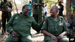FILE - South Sudan's rebel leader Riek Machar, left, and his wife, Angelina Teny, joke in front of their tent in a rebel-controlled area in Jonglei State, South Sudan, Jan. 31, 2014.