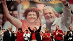 FILE - Brazil's President Luiz Inacio Lula da Silva, center, raises arms with his Chief of Staff Dilma Rousseff at an annual Workers Party Congress in Brasilia, Brazil, Feb. 20, 2010.