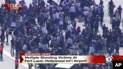 Gambar diambil dari video NBC TV Local10 menunjukan orang-orang berdiri di luar setelah insiden penembakan di bandara internasional Fort Lauderdale, Florida.