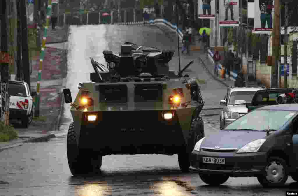 A Kenya Defence Forces armored military vehicle drives to the Westgate Mall after an exchange of gunfire inside the mall in Nairobi, Sept. 24, 2013.