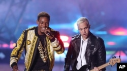 Fetty Wap, left, and Pete Wentz perform at the MTV Movie Awards at the Nokia Theater, on April 12, 2015, in Los Angeles.