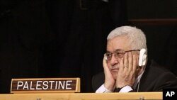 Palestinian President Mahmoud Abbas listens to US President Barack Obama's remarks during the 66th session of the General Assembly at United Nations headquarters, New York, September 21, 2011.