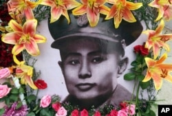 A portrait of Gen. Aung San is decorated with flowers during a ceremony marking the 70th anniversary of his 1947 assassination in Naypyitaw, Myanmar, July 19, 2017.
