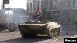Combatientes de Hezbollah colaboran con las tropas del gobierno de Siria en la lucha contra los rebeldes.