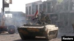 Pasukan Suriah merangsek ke pusat kota Qusair (5/6) setelah menguasai kota strategis itu dengan bantuan kelompak Hizbullah dari Lebanon.