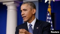 美国总统奥巴马在记者会上(2014年12月19日)
