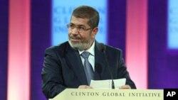 Presiden Mesir Mohammed Morsi berbicara tentang tantangan yang dihadapi negaranya dan kawasan Timur Tengah dalam forum Clinton Global Initiative di New York, Selasa (25/9).