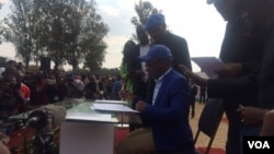 Signing the MDC Alliance agreement.