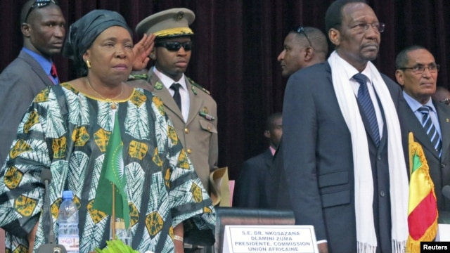 African Union Chief Nkosazana Dlamini-Zuma (front L) and Mali's President Dioncounda Traore attend a high level international meeting in Bamako, October 19, 2012. Regional leaders joined international organisations in Bamako on Friday trying to narrow their differences over whether al Qaeda-linked Islamists in the north of Mali should be dislodged via military intervention or a more gradual political approach. REUTERS/Adama Diarra