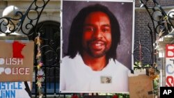 FILE - A memorial including a photo of Philando Castile adorns the gate to the governor's residence in St. Paul, Minn.