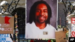 FILE - A memorial including a photo of Philando Castile adorns the gate to the governor's residence, July 25, 2016, where protesters demonstrated in St. Paul, Minn., against the July 6 shooting death of Castile by police officer Jeronimo Yanez.