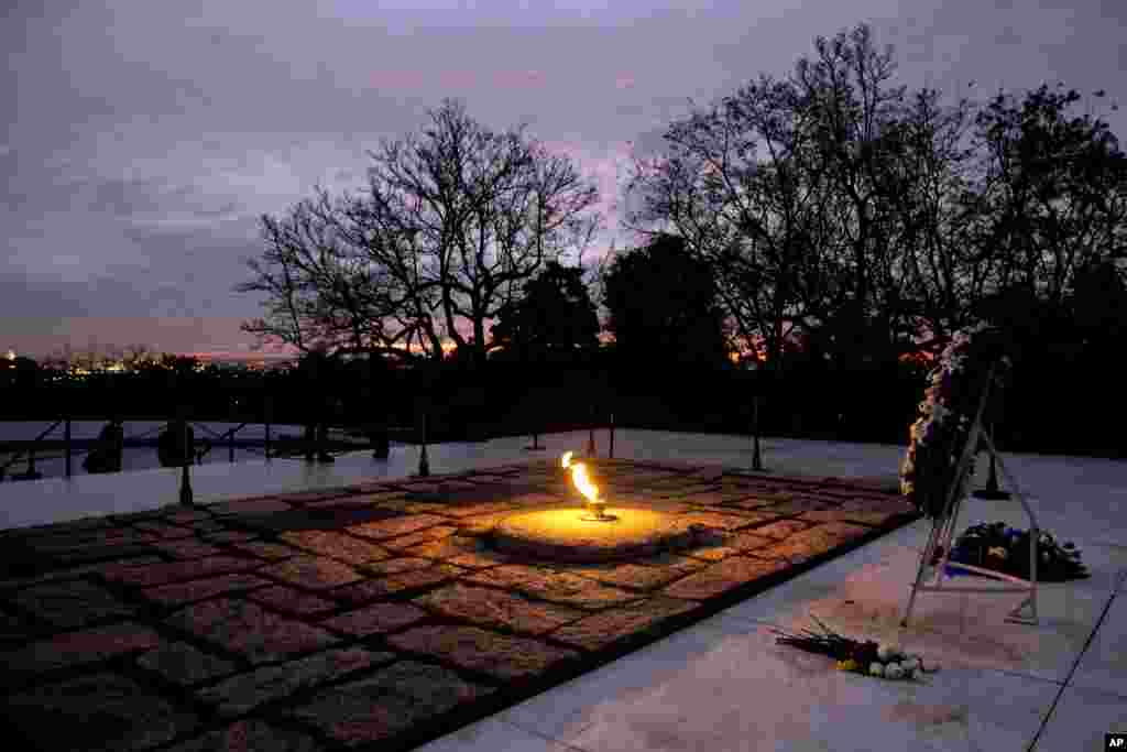 The eternal flame flickers in the early morning light at the grave of John F. Kennedy at Arlington National Cemetery on Nov. 22, 2013, on the 50th anniversary of Kennedy's death.